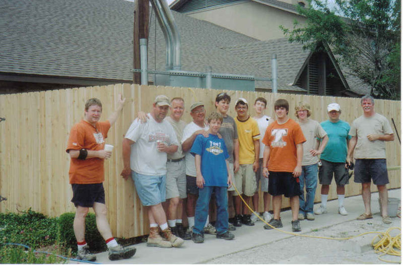 Daniel and his crew in front of St. Mary's new fence in Aug. 2006